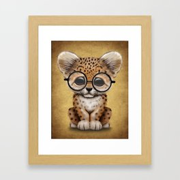 Cute Baby Leopard Cub Wearing Glasses on Yellow Framed Art Print