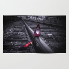 leaving Tracks red high heel shoes on the railroad tracks Rug