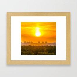 burning sun over the city Framed Art Print