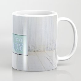 Empty bright interior with copy space and sign with text Coffee Mug
