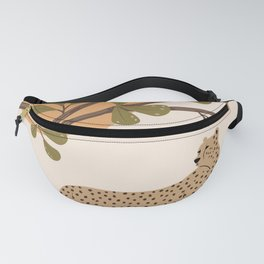 Cheetah on the rocks under the tree Fanny Pack