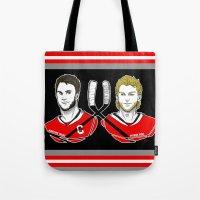 blackhawks Tote Bags featuring Toews & Kane by Kana Aiysoublood