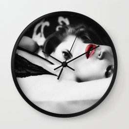 hot girls lying on a bed Wall Clock