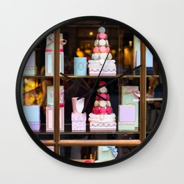 Beautiful colorful tasty macaroons cakes sweets and presents in the boxes display in window at the  Wall Clock