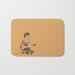 Muddy Waters riding a small bicycle Bath Mat