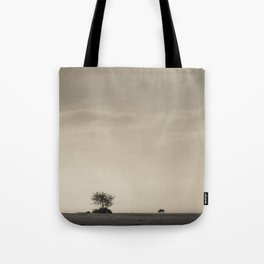 Lone Wildebeest grazing in South Africa Tote Bag