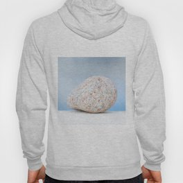 Granite pebble with blue water background Hoody