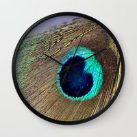 peacock feather Wall Clocks featuring Peacock feather by Hannah