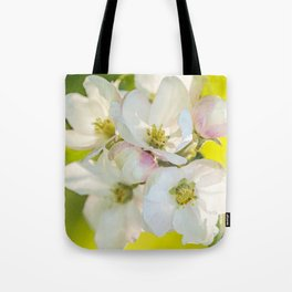Close-up of Apple tree flowers on a vivid green background - Summer atmosphere Tote Bag