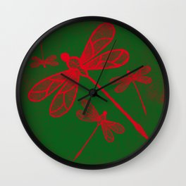 Red embroidered dragonflies on green textured background Wall Clock