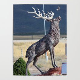 Bird Flying From Stag Deer Statue Poster