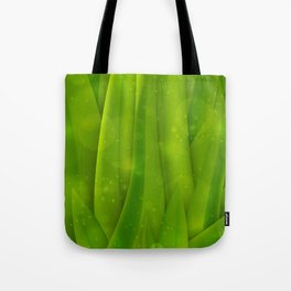 background in pastel colors with green grass and dew Tote Bag
