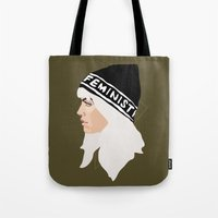 feminist Tote Bags featuring Feminist (Gold) by Anna McKay