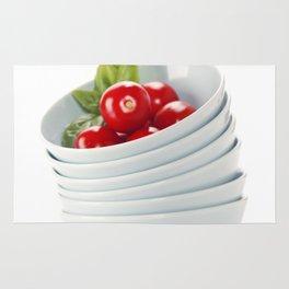 Fresh vegetables in bowls over white Rug