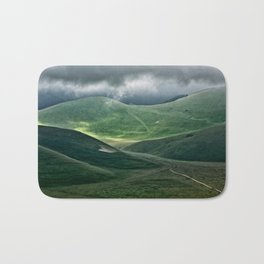 The hills of Castelluccio during a thunderstorm Bath Mat
