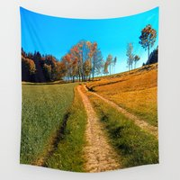 hiking Wall Tapestries featuring Hiking trail following the trees by Patrick Jobst