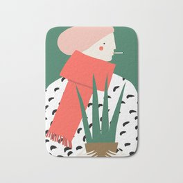 Woman in a red scarf Bath Mat
