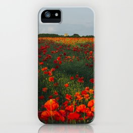 Church and field of red poppies in evening light. Holme Hale, Norfolk, UK iPhone Case