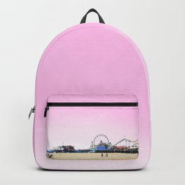 Santa Monica Pier with Ferries Wheel and Roller Coaster Against a Pink Sky Backpack