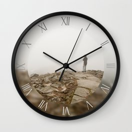 Woman standing in fog at the peak Wall Clock