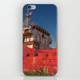 Huge old ship abandoned and corroded by the passage of time iPhone Skin