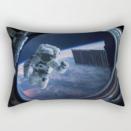 Astronaut in outer space through the porthole Rectangular Pillow