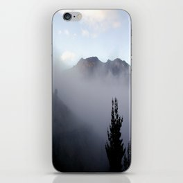 Fog covering Cradle Top Mountain  iPhone Skin