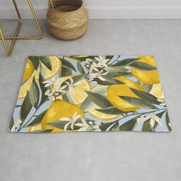 Exquisite pattern with yellow bergamot fruits, citrus fruit branches with white flowers, and green leaves on a blue background. Elegant summer surface pattern Rug