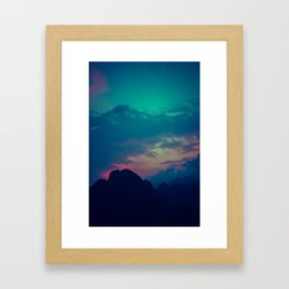 Blue and pink evening sky over the limestone mountains in the Vang Vieng province in Laos. Framed Art Print