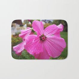 Lavatera flower with water drops in the morning Bath Mat