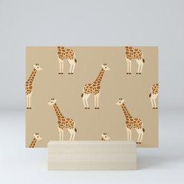 Giraffes on brown Mini Art Print