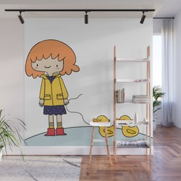 Little girl with duckies Wall Mural