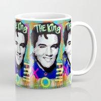 elvis presley Mugs featuring Elvis Presley  by Paola Gonzalez