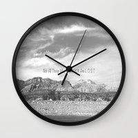 not all those who wander are lost Wall Clocks featuring Not All Those Who Wander Are Lost by Heather Hartley