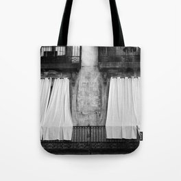 Black & white photo of white curtains on a balcony Tote Bag