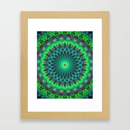 Glowing mandala in bright green and purple Framed Art Print