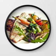 Branzino filet, chorizo dumplings, baby vegetables and spinach sauce Wall Clock