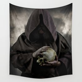 Holding a male skull Wall Tapestry