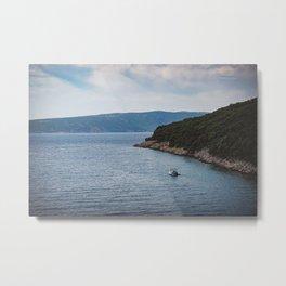 Boat leaving Valbiska bay Metal Print