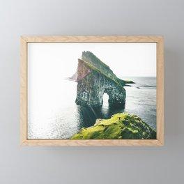 on top of the rock at faroe Framed Mini Art Print