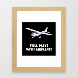 Plays With Airplanes Framed Art Print