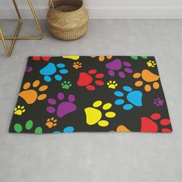 Colorful paw print black background Rug