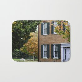 Brick house with Fall leaves Bath Mat