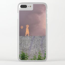 Sunset with girl walking on a wall followed by a balloon Clear iPhone Case