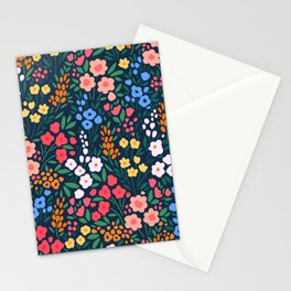 Vintage floral background. Flowers pattern with small colorful flowers on a dark blue background.  Stationery Cards
