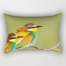 Close-up of colorful bright bee-eaters on tree branch in sunlight. Rectangular Pillow