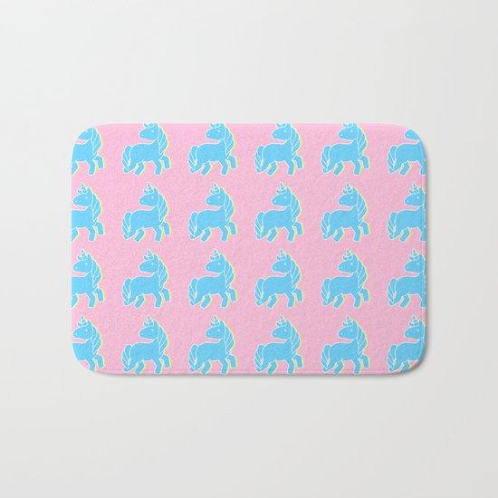 Blue unicorn in a pink world Bath Mat