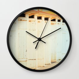 Beach cabins shortly after dawn in winter Wall Clock