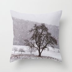 Old pear tree on a wintery meadow Throw Pillow