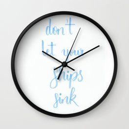 """simple lettering in baby-blue """"don't let your ships sink"""" (Fandom / OTP) Wall Clock"""
